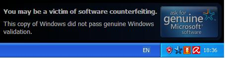 Peringatan tentang kemungkinan kita menggunakan Windows bajakan.
